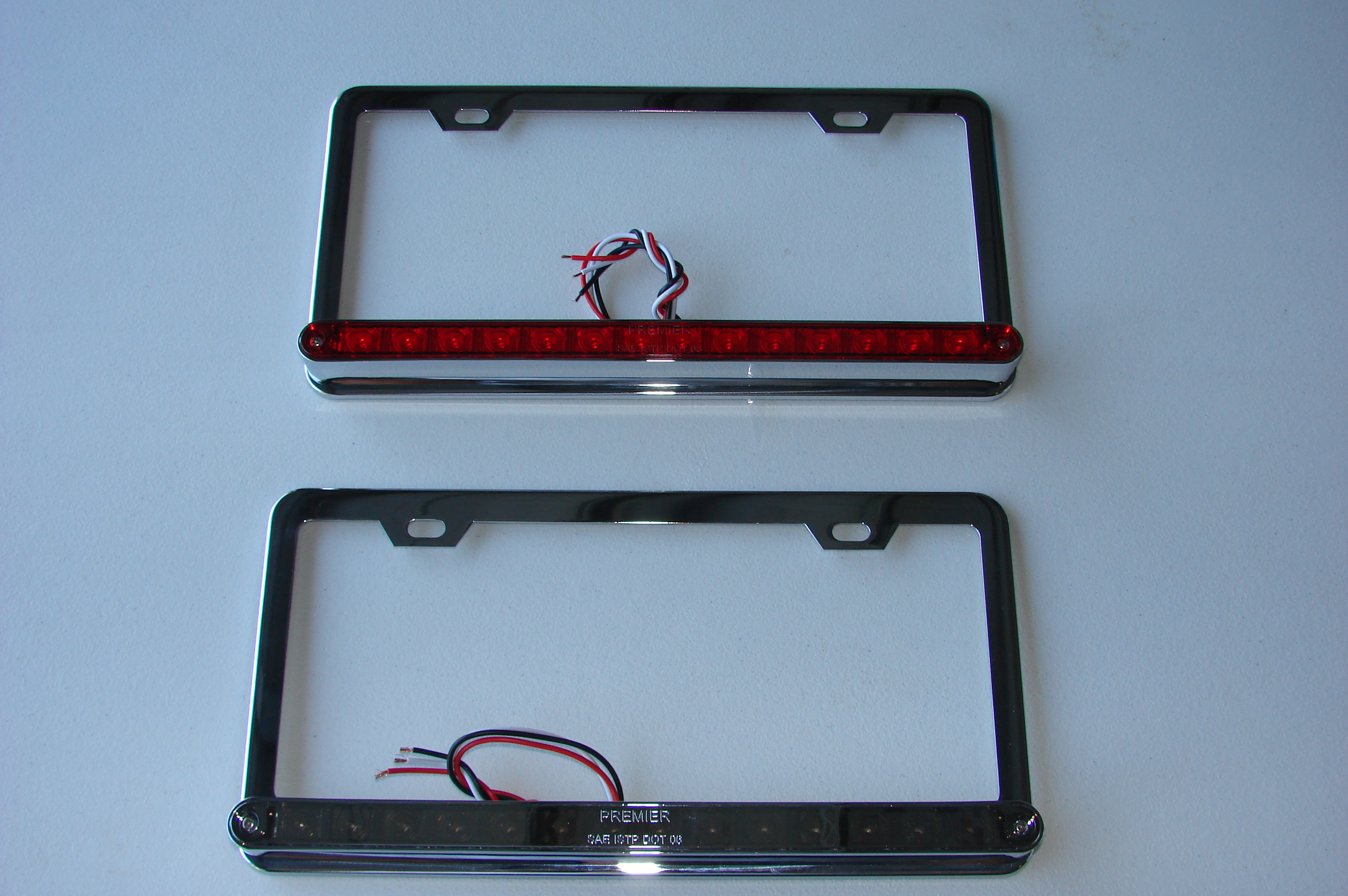 led license plate frames with running lights and 3rd brake light available in red clear and chrome lenses